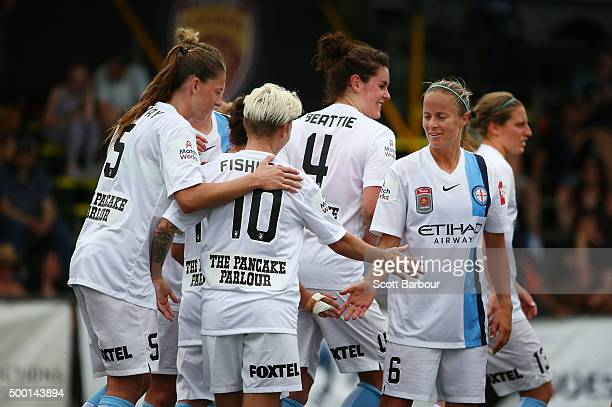 Aivi Luik and Jessica Fishlock of City celebrate after Larissa Crummer of City scored the second goal during the round eight WLeague match between...