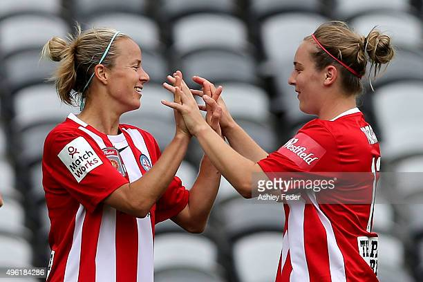 Aivi Luik and Marianna Tabain of Melbourne City celebrate a goal during the round four WLeague match between Canberra United and Melbourne City FC at...