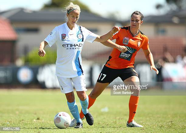 Aivi Luik of City and Emily Gielnik of the Roar compete for the ball during the round six WLeague match between Melbourne City and the Brisbane Roar...