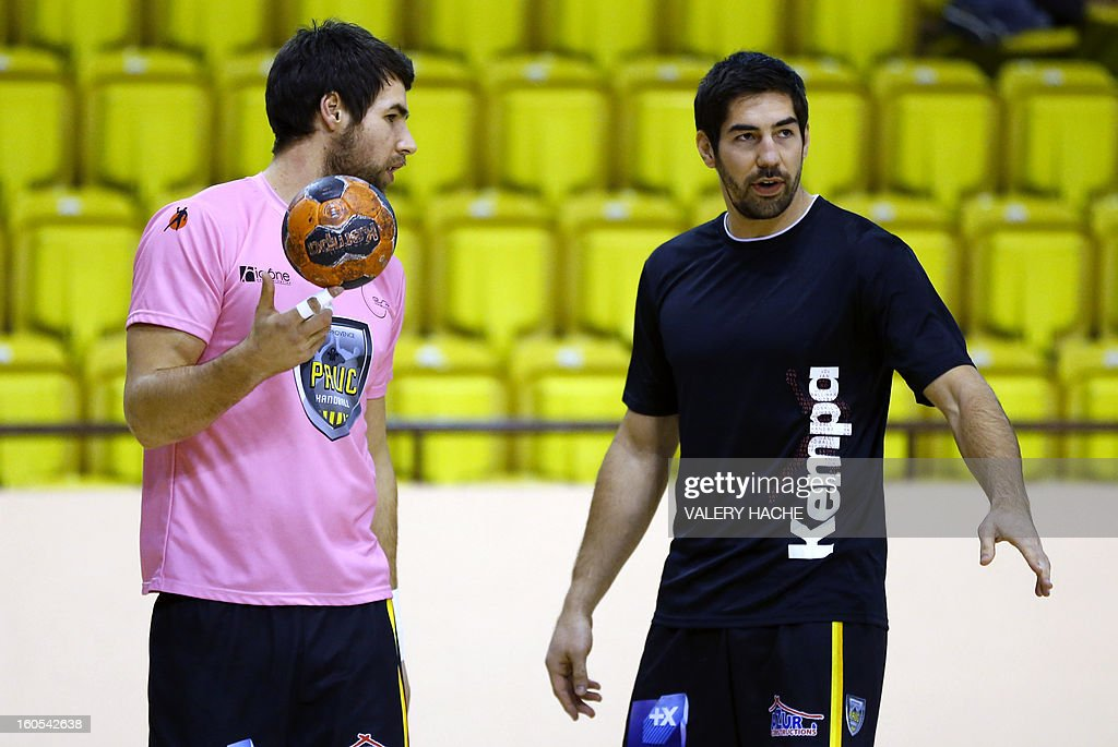 Aix-en-Provence's handball players Nikola Karabatic (R) and Luka Karabatic (L) speak before their French Cup handball match Monaco (N3) vs Aix-en-Provence (D1) on February 2, 2013 at the 'Louis II' stadium in Monaco.