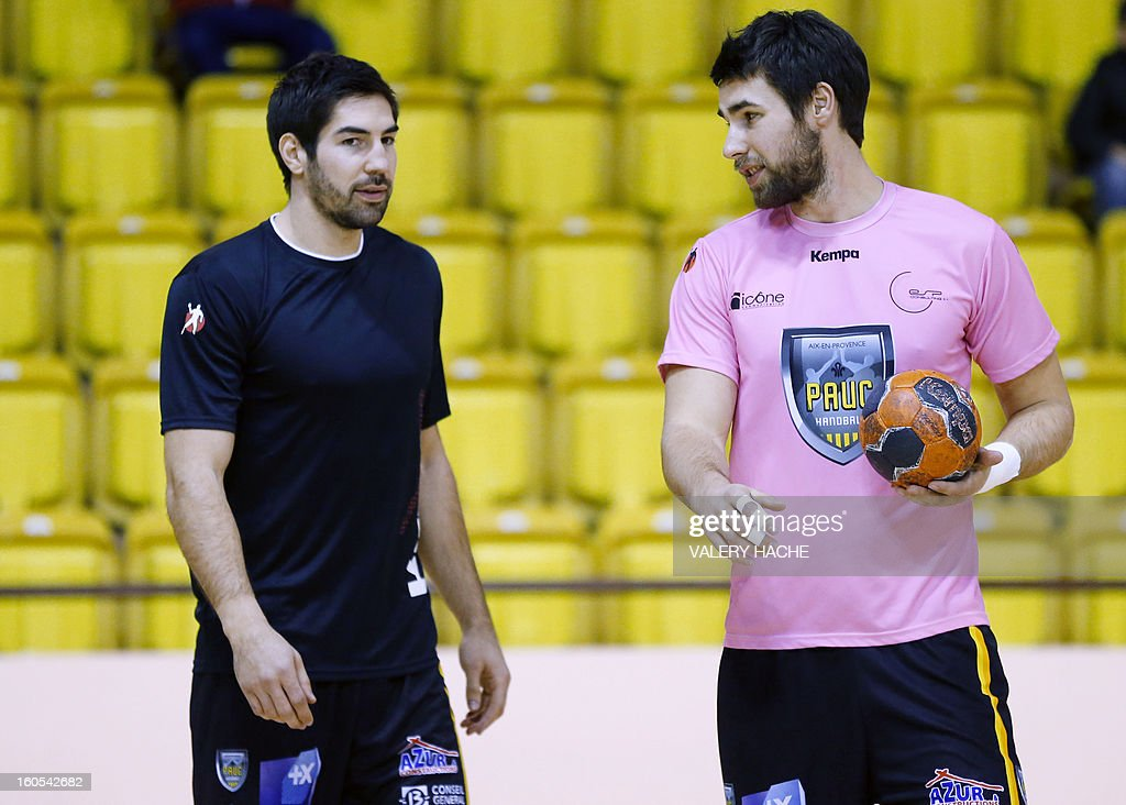 Aix-en-Provence's handball players Nikola Karabatic (L) and Luka Karabatic (R) speak before their French Cup handball match Monaco (N3) vs Aix-en-Provence (D1) on February 2, 2013 at the 'Louis II' stadium in Monaco.