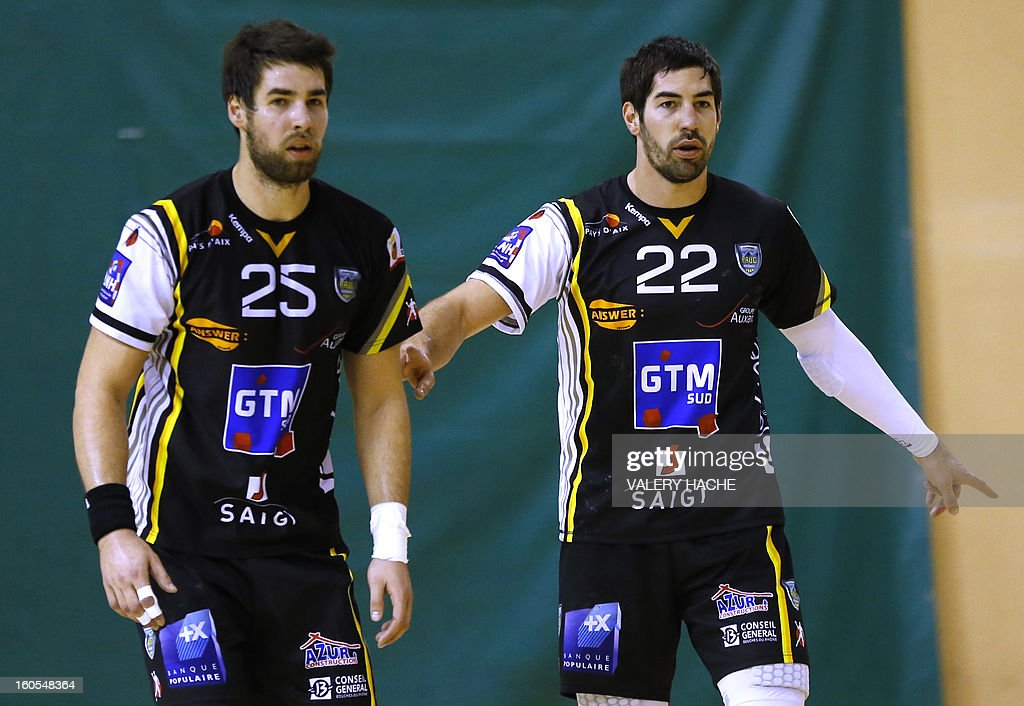 Aix-en-Provence's handball players Nikola Karabatic (R) and Luka Karabatic (L) play during their French Cup handball match Monaco (N3) vs Aix-en-Provence (D1) on February 2, 2013 at the 'Louis II' stadium in Monaco.