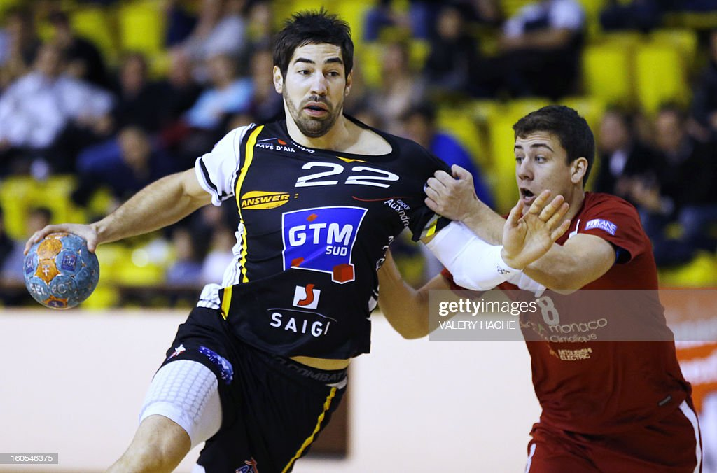 Aix-en-Provence's handball players Nikola Karabatic (L) controls the ball during the French Cup handball match Monaco (N3) vs Aix-en-Provence (D1) on February 2, 2013 at the 'Louis II' stadium in Monaco.