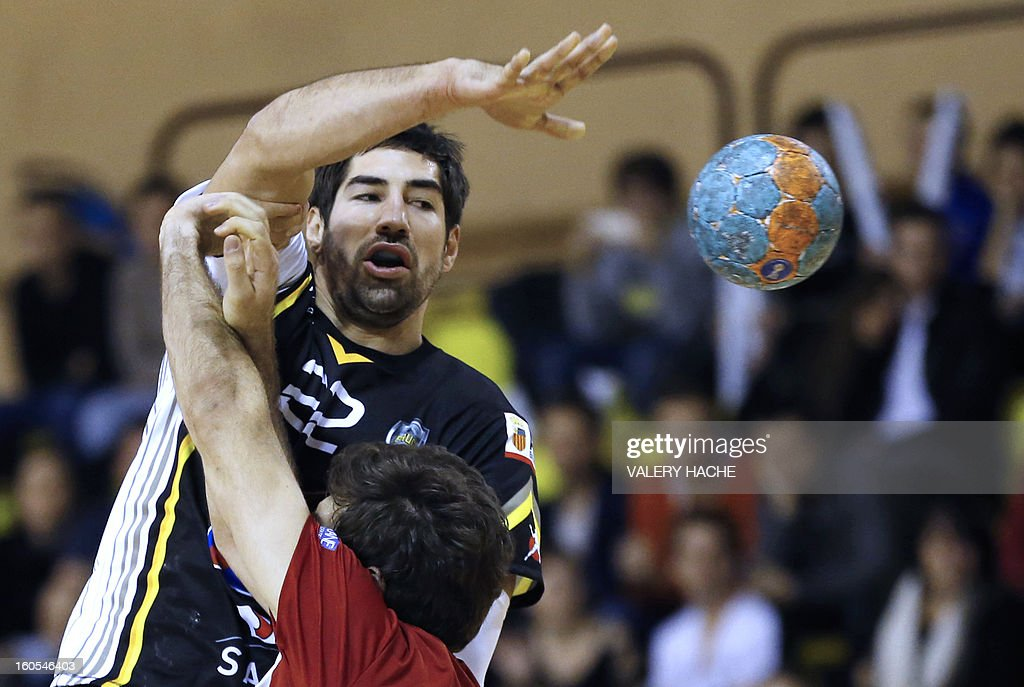 Aix-en-Provence's handball players Nikola Karabatic (Up) shoots during the French Cup handball match Monaco (N3) vs Aix-en-Provence (D1) on February 2, 2013 at the 'Louis II' stadium in Monaco.