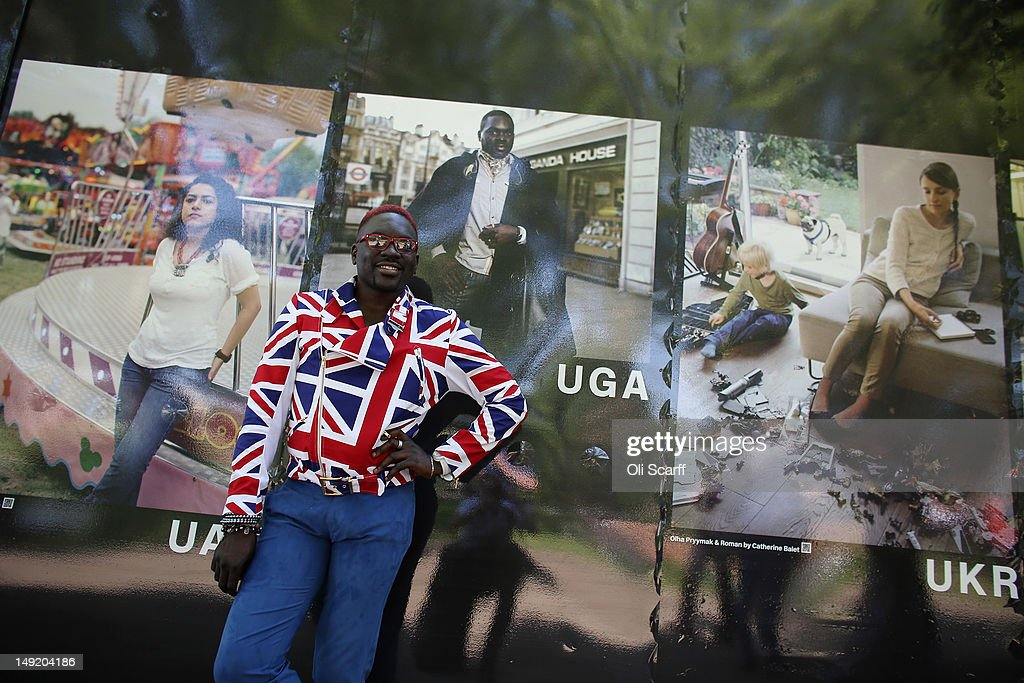 Aizak Buyondon, from Uganda, poses in front of a portrait of himself in the photography exhibition 'The World in London' in Victoria Park on July 25, 2012 in London, England. The project, initiated by The Photographers' Gallery, aimed to commission portraits of 204 Londoners, each originating from one of the nations competing in the London 2012 Olympic Games. The project has taken three years to come to fruition and the Photographers' Gallery is still seeking to find sitters from six nations to complete the full set, namely: American Samoa, FS Micronesia, Guam, Marshall Islands, Nauru and Palau.