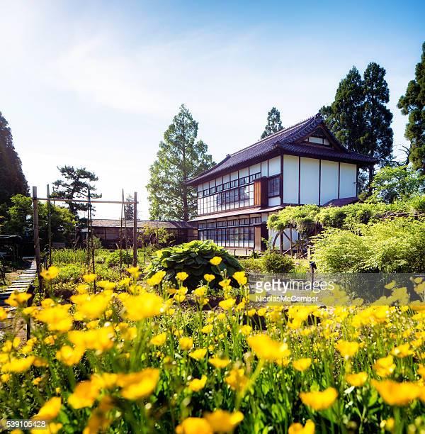 Aizuwakamatsu Oyakuen Garden maintenance building with poppies