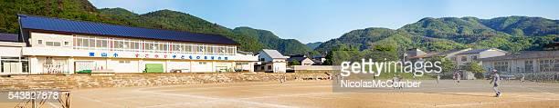 Aizwakamatsu elementary school panorama with baseball team practicing