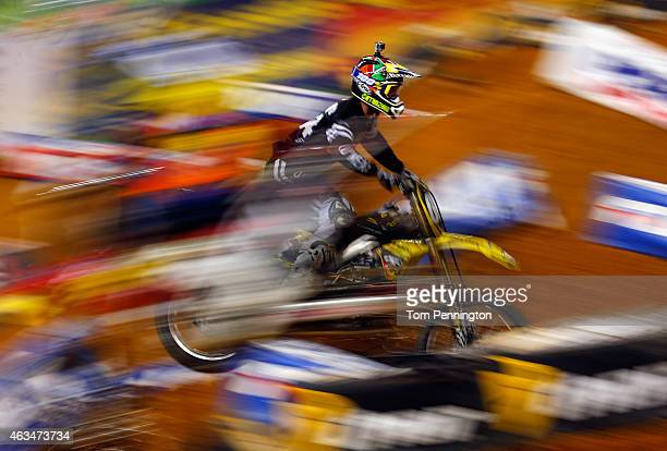 Aj Catanzaro rider of the Suzuki RMZ races the field during the 250SX Main during the Monster Energy AMA Supercross at ATT Stadium on February 14...
