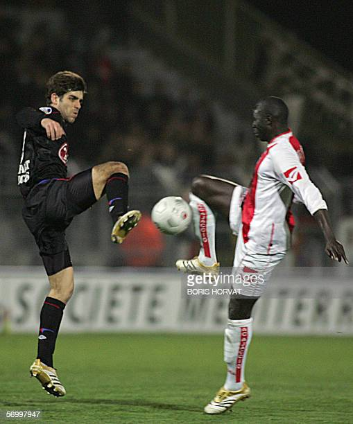 Lyon's midfielder Juninho from Brazil vies with AC Ajaccio forward Moussa N'Diaye from Senegal during the L1 football match AjaccioLyon04 March 2006...