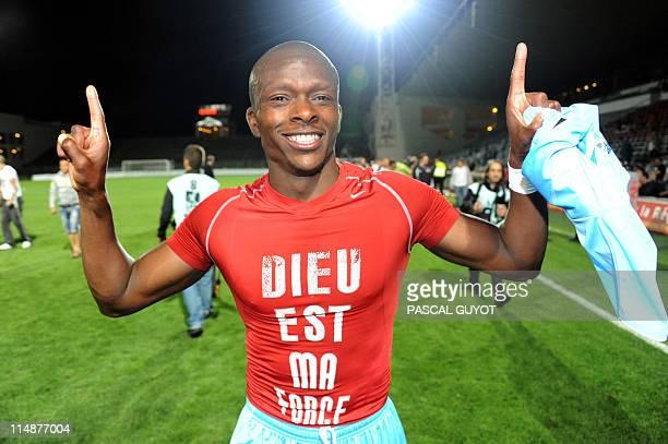 Ajaccio's Christian Kinkela jubilates after his side earned promotion to L1 following their victory in the French L2 football match Nîmes vs Ajaccio...