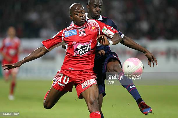 Ajaccio's congolese defender Christian Kinkela vies with Lyon's defender Aly Cissokho during the French L1 football match Ajaccio vs Lyon in the...