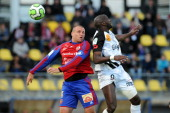 Ajaccio's defender Rodéric Filippi vies with Guingamp's forward Moustapha Yatabaré during the French L2 football match Ajaccio vs Guingamp on May 17...