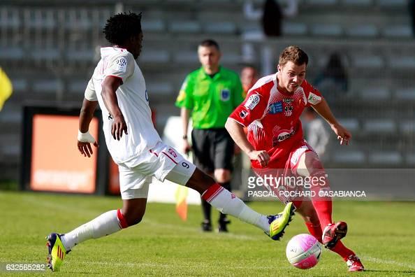 Ajaccio's defender Samuel Bouhours vies with Nancy's forward Benjamin Moukandjo Bile during the french L1 football match Ajaccio vs Nancy in the...