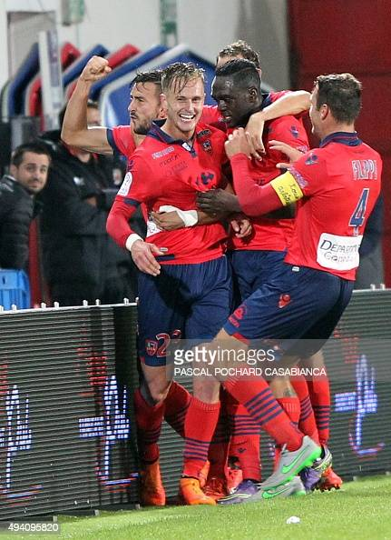 Ajaccio's Dutch midfielder Damjan Djokovic celebrates with teammates after scoring a goal during the French L1 football match between Gazelec Ajaccio...