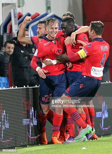 Ajaccio's Dutch midfielder Damjan Djokovic celebrates with teammates after scoring a goal during the French L1 football match between Gazelec Ajaccio...