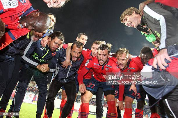 Ajaccio's football club players celebrate at the end of the L1 football match Gazelec Ajaccio against Bordeaux on October 31 at the Ange Casanova...