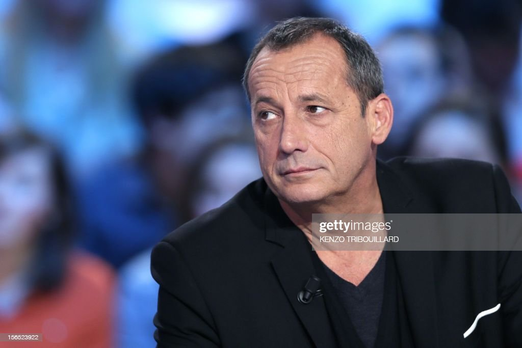 Ajaccio's football club president Alain Orsoni takes part in the TV show 'Le grand journal' on a set of French TV Canal+, on November 16, 2012 in Paris.