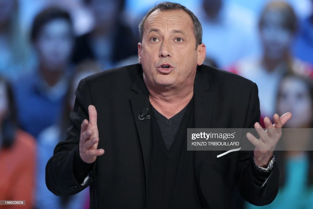 Ajaccio's football club president Alain Orsoni takes part in the TV show 'Le grand journal' on a set of French TV Canal+, on November 16, 2012 in Paris. AFP PHOTO/KENZO TRIBOUILLARD