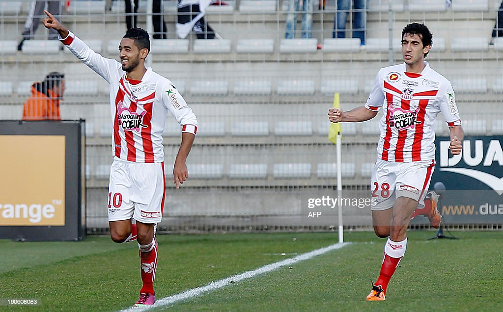 Ajaccio's Franco-Moroccan midfielder Chahir Belghazouani (L) celebrates after scoring a goal during the French L1 football match Ajaccio (ACA) vs Lyon (OL) in the Francois Coty stadium in Ajaccio, French mediterranean island of Corsica, on February 3 , 2013.