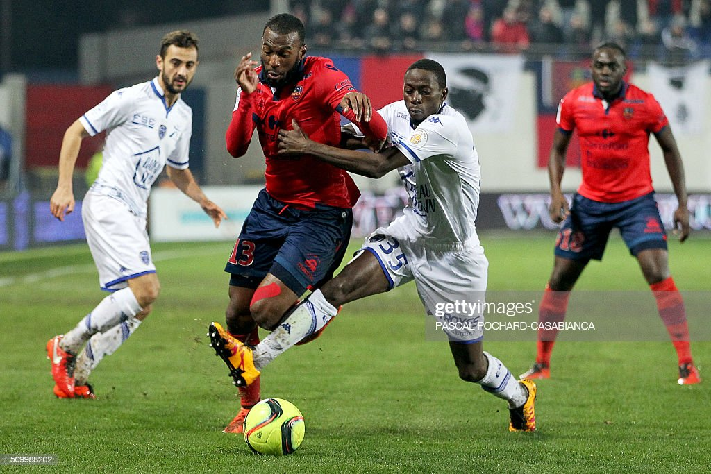 Ajaccio's French defender Alassane Toure (L) vies for the ball with Troyes' French defender Mouhamadou Dabo during the French L1 football match between Gazelec Ajaccio (GFCA) and Troyes (ESTAC) on February 13, 2016, at the Ange Casanova stadium in Ajaccio, on the French Mediterranean island of Corsica. AFP PHOTO / PASCAL POCHARD-CASABIANCA / AFP / PASCAL POCHARD-CASABIANCA