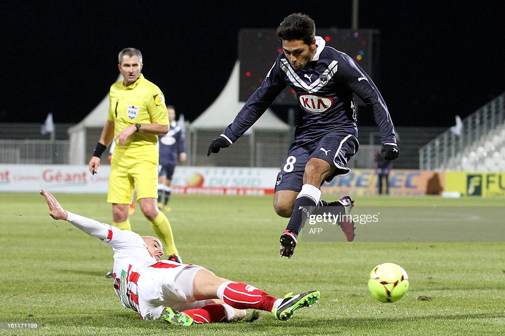 Ajaccio's French defender Matthieu Chalme (L) vies with Bordeaux's French midfielder Benoit Tremoulinas during the French Ligue1 football match Ajaccio (ACA) vs Bordeaux (GDB) in the Francois Coty stadium in Ajaccio, French mediterranean island of Corsica, on February 9 , 2013.
