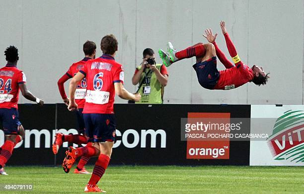 Ajaccio's French defender Roderic Filippi celebrates after scoring a goal during the French L1 football match between Gazelec Ajaccio and Nice on...