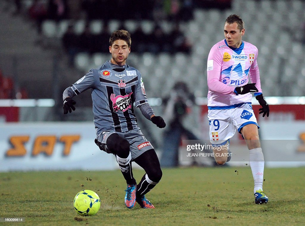 Ajaccio's French defender Samuel Bouhours (L) vies with Evian's French forward Kevin Berigaud during their French L1 football match Evian (ETGFC) vs Ajaccio (ACA) on January 26, 2013 at the city stadium Parc des sports in Annecy, eastern France.