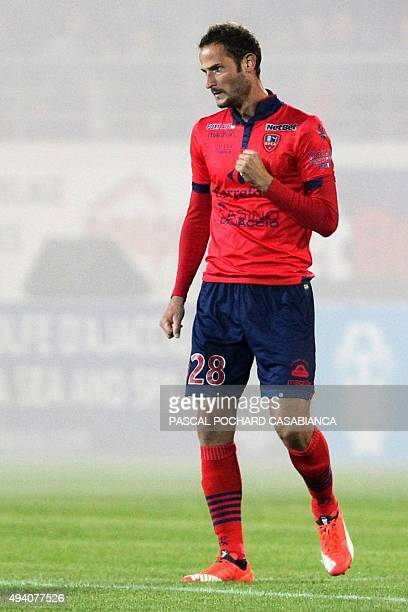 Ajaccio's French forward Gregory Pujol celebrates after scoring a goal during the French L1 football match between Gazelec Ajaccio and Nice on...