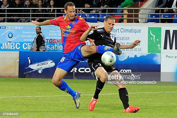 Ajaccio's French forward Gregory Pujol vies with Niort's French midifielder Antoine Batisse during the French L2 football match between Ajaccio and...