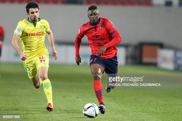 Ajaccio's French forward Kevin Mayi vies with Nantes' French defender Leo Dubois during the French L1 football match Gazelec Ajaccio against Nantes...