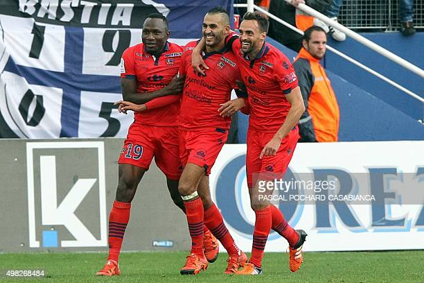 Ajaccio's French forward Khalid Boutaib is congratulated by teammates after scoring a goal during the L1 football match Bastia against Gazelec...