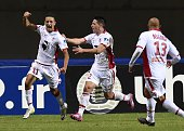 Ajaccio's French forward Mouaad Madri celebrates with team mates after scoring a goal during a French League Cup football match between Montpellier...