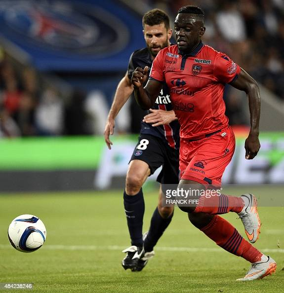 Ajaccio's French midfielder Amos Youga vies with Paris SaintGermain's Italian midfielder Thiago Motta during the French L1 football match Paris...