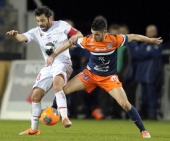 Ajaccio's French midfielder Johan Cavalli vies for the ball with Montpellier's French mifielder Morgan Sanson during the French L1 football match...