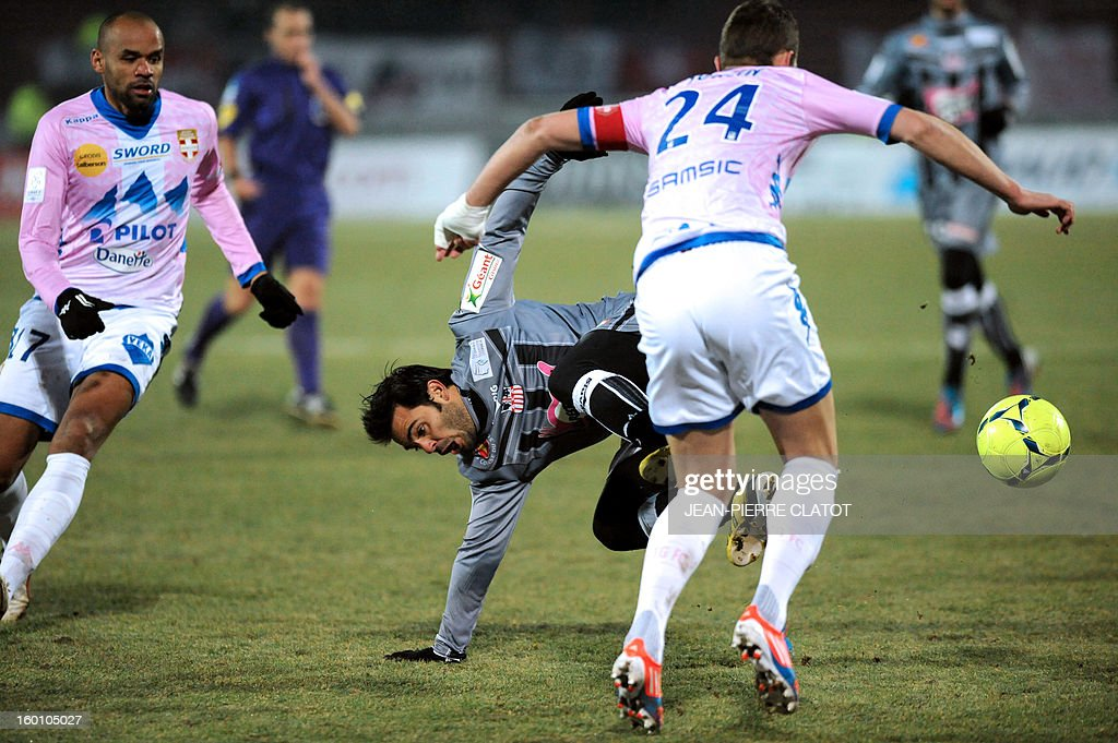 Ajaccio's French midfielder Johan Cavalli (C) vies with Evian's French midfielder Olivier Sorlin (R) during their French L1 football match Evian (ETGFC) vs Ajaccio (ACA) on January 26 , 2013 at the city stadium Parc des sports in Annecy, eastern France.