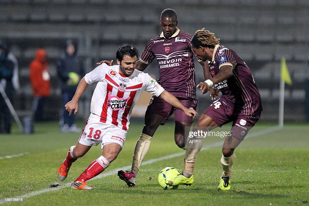 Ajaccio's French midfielder Johan Cavalli (L) vies with Valenciennes' French midfielder Youssoune Sankhare (C) and Valenciennes' Cameroonian defender Gaetan Bong during the French L1 football match Ajaccio (ACA) vs Valenciennes (VAFC) at the Francois Coty stadium in Ajaccio, French mediterranean island of Corsica, on January 19, 2013.
