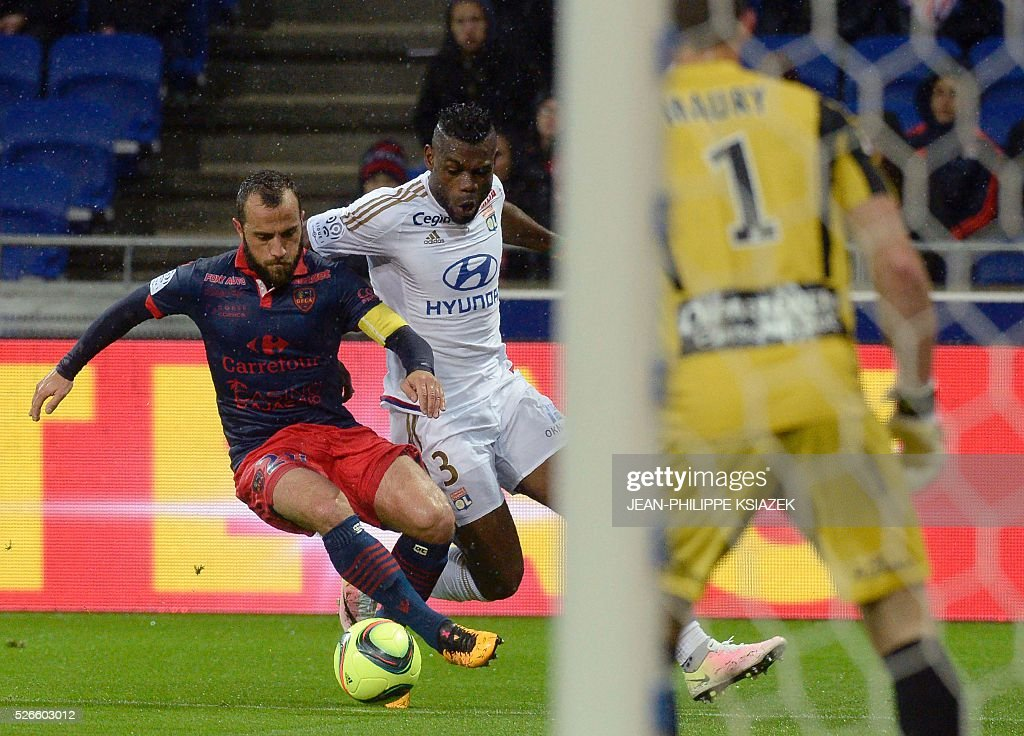 Ajaccio's French midfielder Louis Poggi (L) vies with Lyon's French Cameroonian defender Henri Bedimo (C) during the French L1 football match Lyon (OL) vs Ajaccio (GFCA) at the Parc Olympique Lyonnais stadium in Decines-Charpieu, central eastern France, on April 30, 2016.