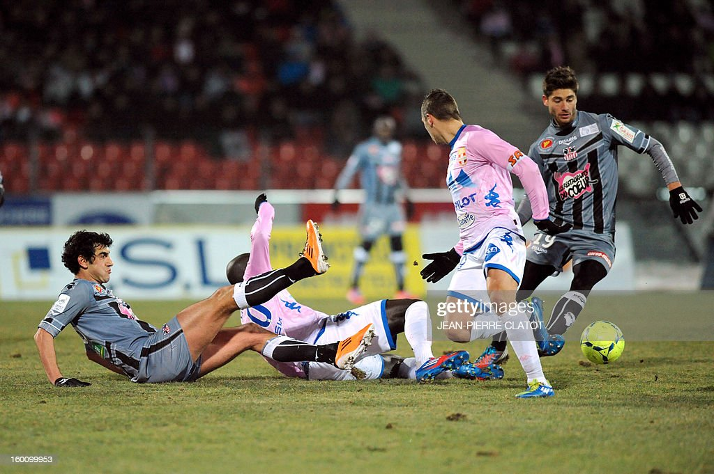 Ajaccio's French midfielder Paul Lasne (R) vies with Evian's French forward Kevin Berigaud (2ndR) during the French L1 football match Evian (ETGFC) vs Ajaccio (ACA) on January 26, 2013, at the city stadium Parc des sports in Annecy, eastern France.