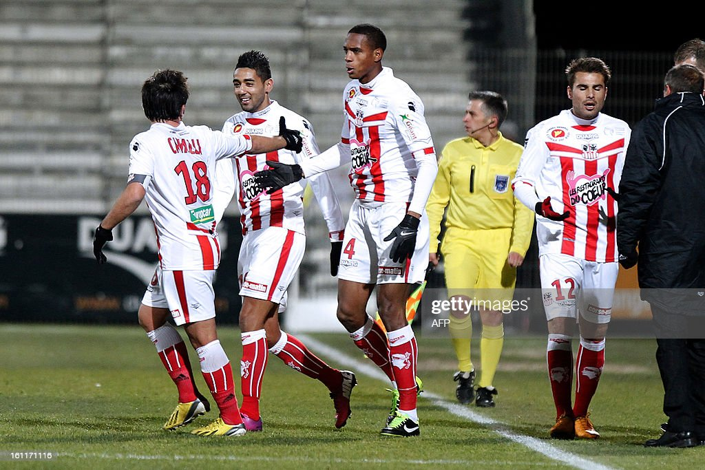 Ajaccio's French midfielder Ricardo Faty is congratulated by teammates after scoring a goal during the French Ligue1 football match Ajaccio (ACA) vs Bordeaux (GDB) in the Francois Coty stadium in Ajaccio, French mediterranean island of Corsica, on February 9 , 2013.