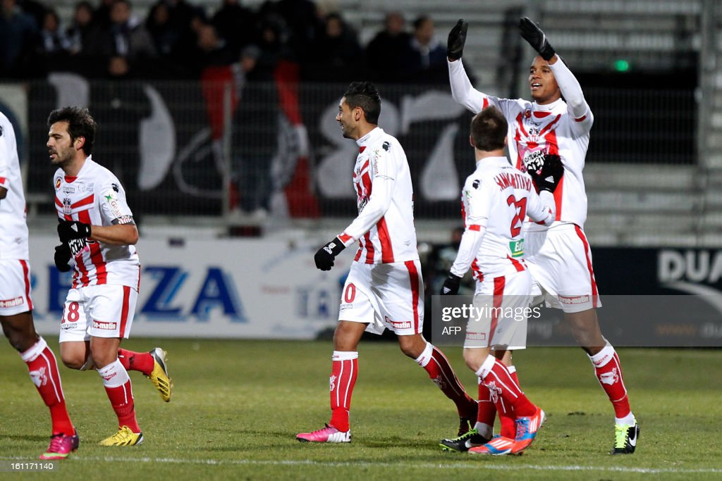 Ajaccio's French midfielder Ricardo Faty is congratulated by teammates after scoring a goal during the French Ligue1 football match Ajaccio (ACA) vs Bordeaux (GDB) in the Francois Coty stadium in Ajaccio, French mediterranean island of Corsica, on February 9 , 2013. AFP PHOTO / PASCAL POCHARD-CASABIANCA
