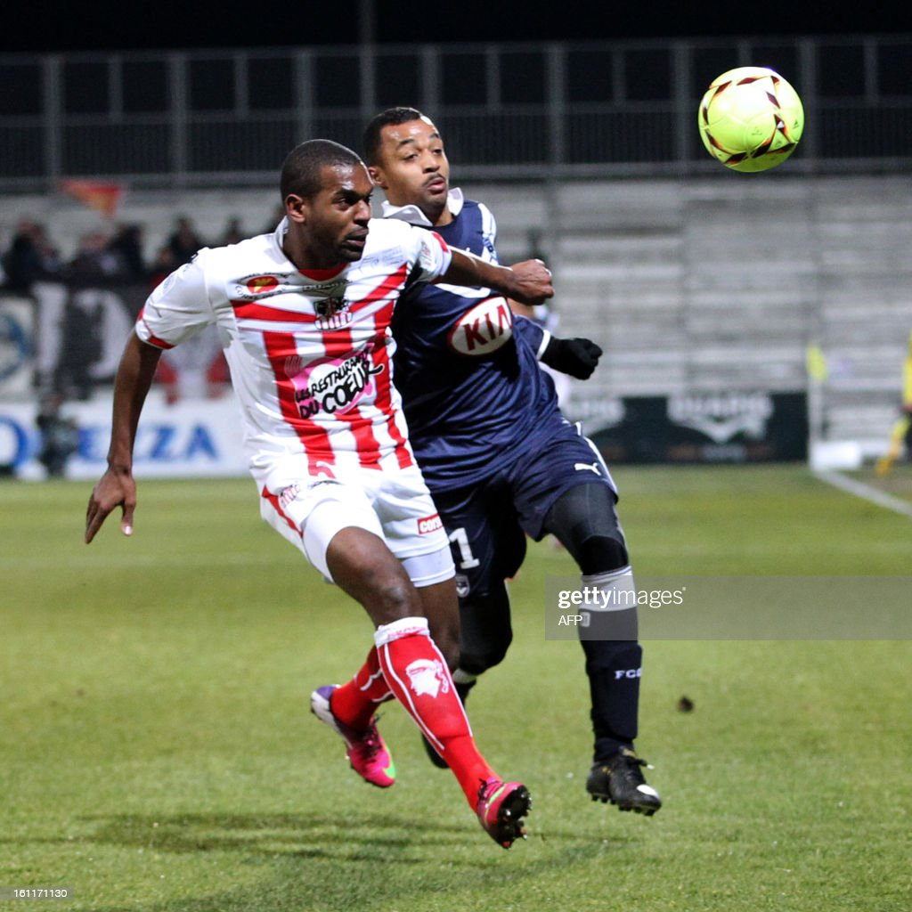 Ajaccio's French midfielder Ronald Zubar vies with Bordeaux's French forward David Bellion during the French Ligue1 football match Ajaccio (ACA) vs Bordeaux (GDB) in the Francois Coty stadium in Ajaccio, French mediterranean island of Corsica, on February 9 , 2013.