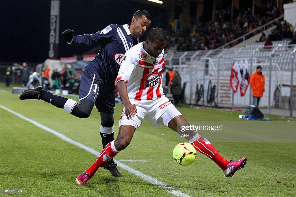 Ajaccio's French midfielder Ronald Zubar vies with Bordeaux's French forward David Bellion during a French L1 football match between Ajaccio (ACA) and Bordeaux (GDB) at Francois Coty stadium in Ajaccio, Corsica, on February 9 , 2013.
