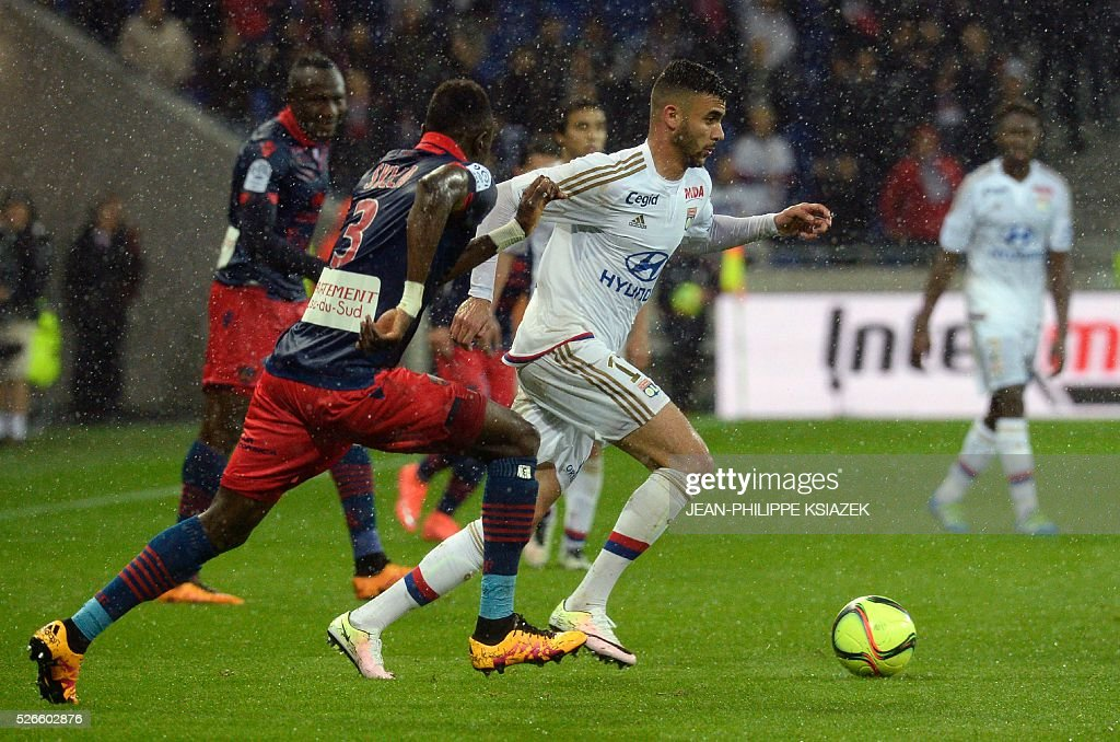 Ajaccio's Guinean defender Issiaga Sylla (L) vies with Lyon's French Algerian midfielder Rachid Ghezzal (R) during the French L1 football match Lyon (OL) vs Ajaccio (GFCA) at the Parc Olympique Lyonnais stadium in Decines-Charpieu, central eastern France, on April 30, 2016.