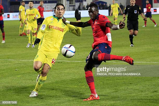 Ajaccio's Guinean defender Issiaga Sylla vies with Nantes' US midfielder Alejandro Bedoya during the French L1 football match Gazelec Ajaccio against...