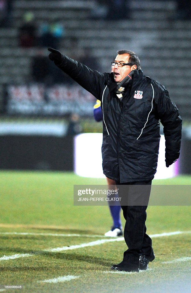 Ajaccio's head coach Albert Emon gestures during the French L1 football match Evian (ETGFC) vs Ajaccio (ACA) on January 26, 2013, at the city stadium Parc des sports in Annecy, eastern France