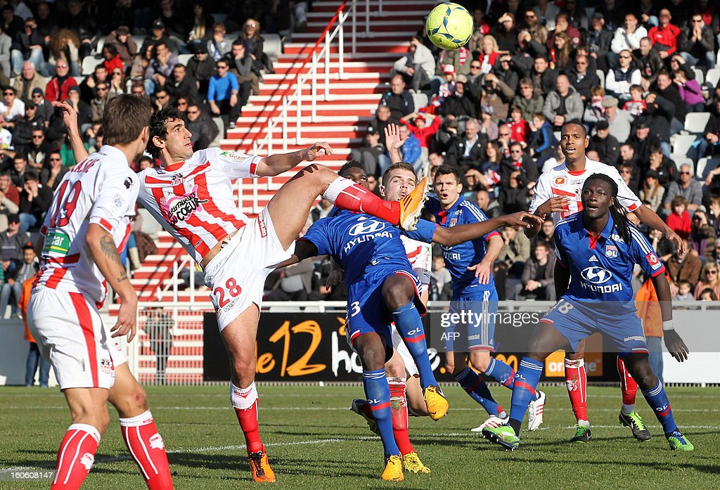 Ajaccio's Italo-Brazilian defender Felipe Saad (L) vies with Lyon's French forward Bafetimbi Gomis (R) during the French Ligue1 football match Ajaccio (ACA) vs Lyon (OL) in the Francois Coty stadium in Ajaccio, French Mediterranean island of Corsica, on February 3, 2013.
