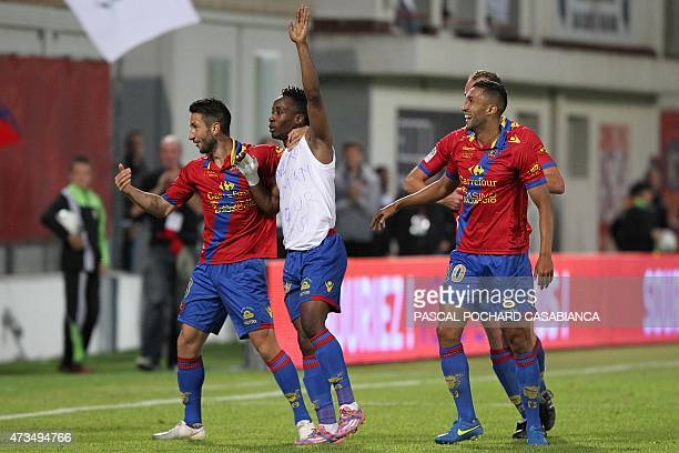 GFC Ajaccio's John Tshibumbu is congratulated by teammates after scoring a goal during the French L2 football match between GFC Ajaccio and Niort on...