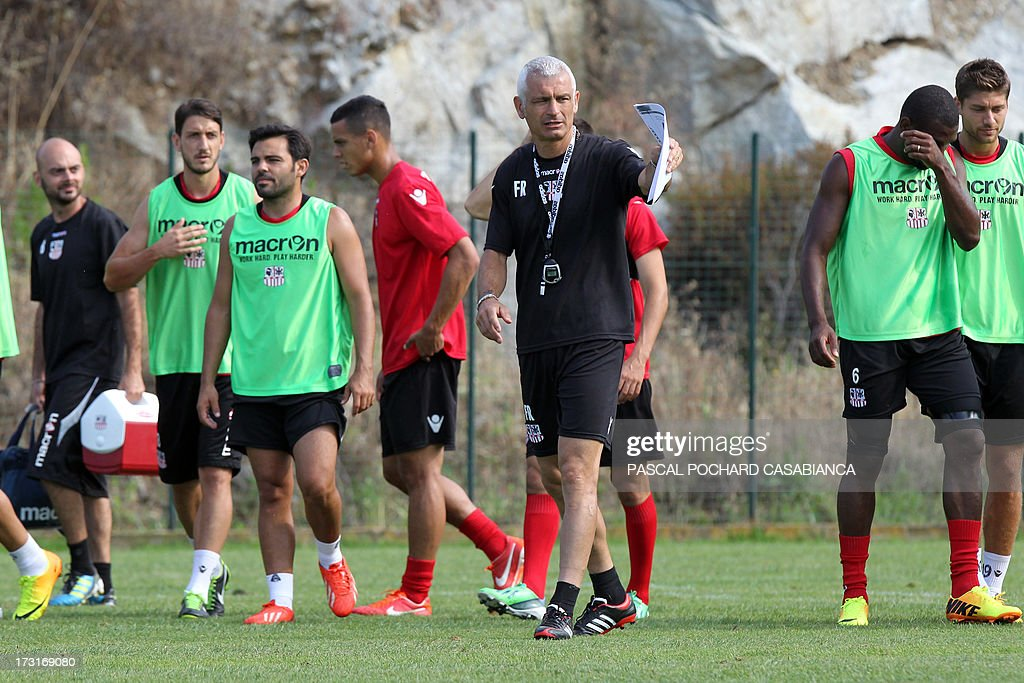 Ajaccio's L1 football club head coach, Italy's Fabrizio Ravanelli (C) attends a training session on July 9, 2013 in Ajaccio, French Mediterranean island of Corsica.