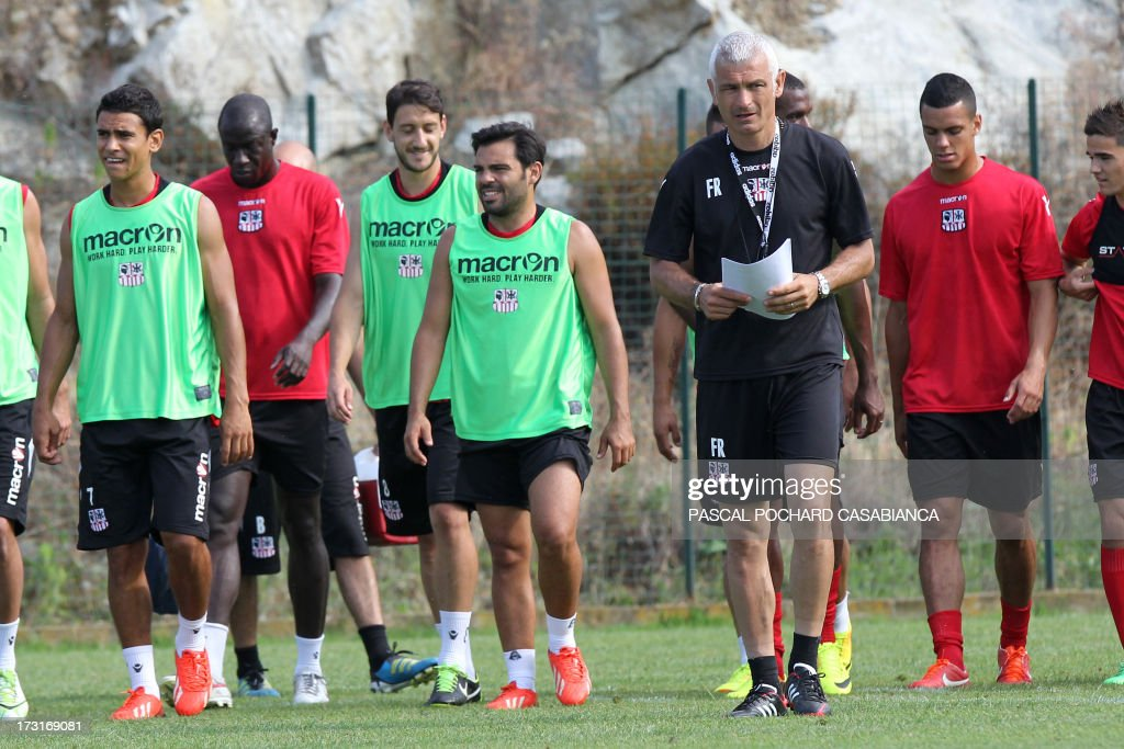Ajaccio's L1 football club head coach, Italy's Fabrizio Ravanelli (C-R) attends a training session on July 9, 2013 in Ajaccio, French Mediterranean island of Corsica.