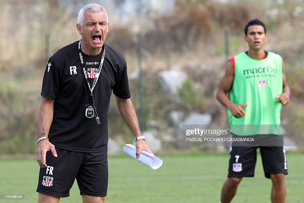 Ajaccio's L1 football club head coach, Italy's Fabrizio Ravanelli (L) attends a training session on July 9, 2013 in Ajaccio, French Mediterranean island of Corsica. AFP PHOTO / PASCAL POCHARD-CASABIANCA